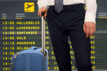 trip over: Business trip.  Businessman with travel bag over airport background