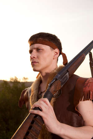 hunting rifle: Hunter in vintage clothes ready to hunt with hunting rifle