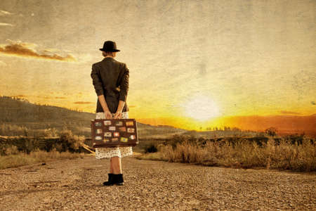 wait: Women with vintage travel suitcase at old road. Photo in old image style