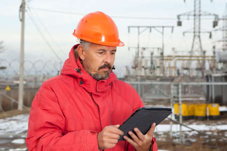 power industry: Engineer at Electrical Substation. Electrical power industry. Electric power distribution