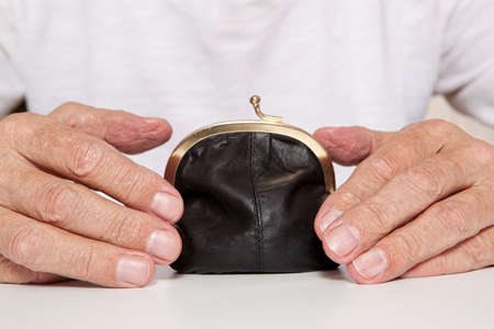 subsidize: Old senior hands and small retro styled money pouch