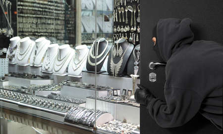 Man wearing a mask robbed a jewelry store. Robbery concept