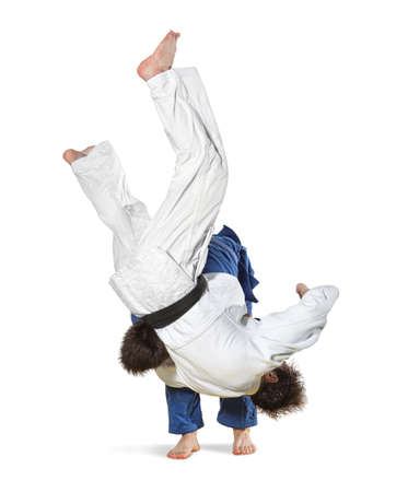 bout: The two judokas fighters fighting men on white background