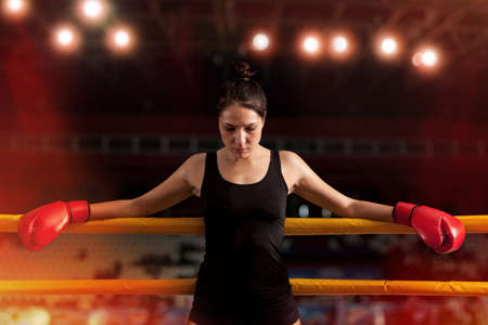 Portrait of woman training gym boxing mma ring Stock Photo