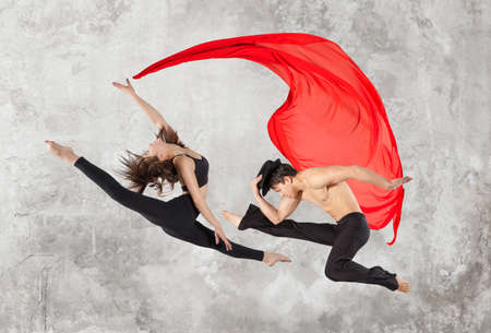 Young couple ballet dancing on wall background Stock Photo