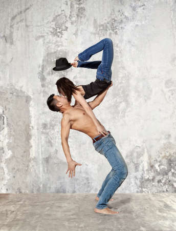 Young couple ballet dancing on wall background 免版税图像 - 70996019