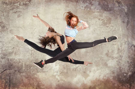 Young woman modern ballet dancing on wall background Stock Photo