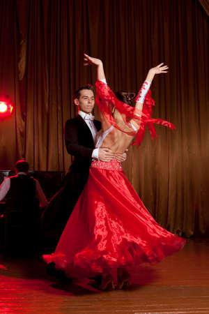 Dance beautiful couple dancing ballroom dancing on dark background Stock Photo