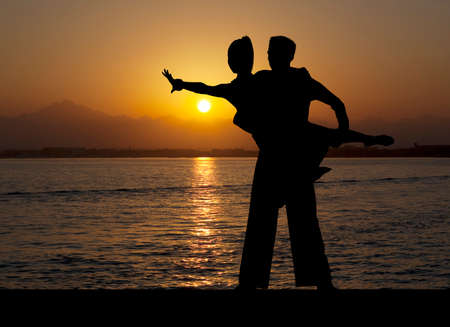 Dance silhouette couple dancing ballroom dancing on sunset  background Stock Photo - 75066508