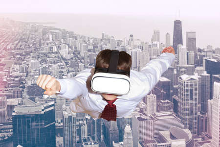 simulator: Businessman superhero wearing virtual reality glasses flying above a city