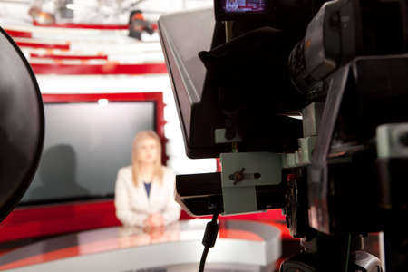 newsreader: A television anchorwoman at studio during live broadcasting