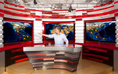 announcer: Weather forecast. A television anchorman at studio during live broadcasting