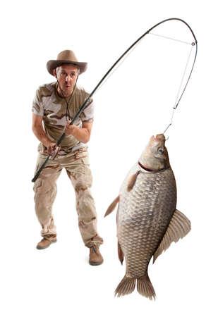 Pescador con peces grandes. Crucian carpa (Carassius auratus gibelio) aislado en blanco Foto de archivo - 80610499
