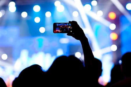 People at concert shooting video or photo Sajtókép