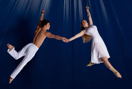 Air gymnast couple performing