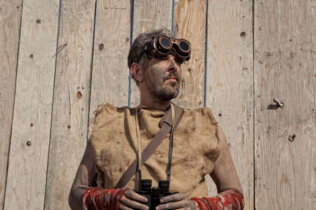 Vintage steampunk man wearing glasses with binoculars photo