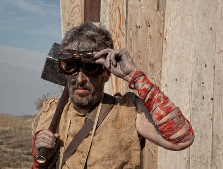 Steampunk man wearing glasses with sledge hammer photo