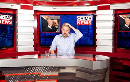 newsreader: Crime news. A television anchorman at studio during live broadcasting
