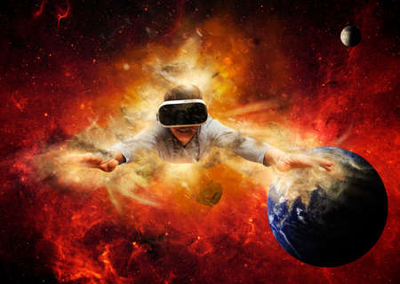 Young man wearing virtual reality glasses. Space