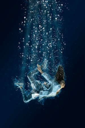 Woman is drowning under water. Horrible dream Stock Photo