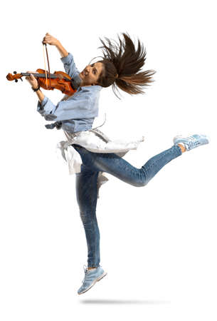 Playing the violin. Young woman playing violin on white isolated background