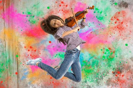 Woman playing violin on on splash background