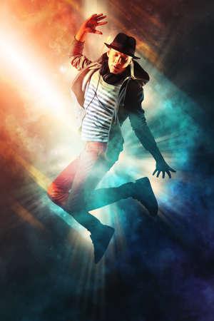 Young man break dancing on smoke background Stock Photo