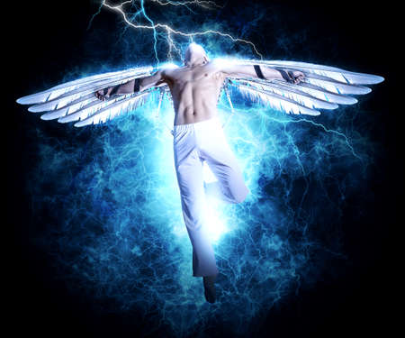 A man with wings on electricity light background. Design for cover book, poster Stockfoto