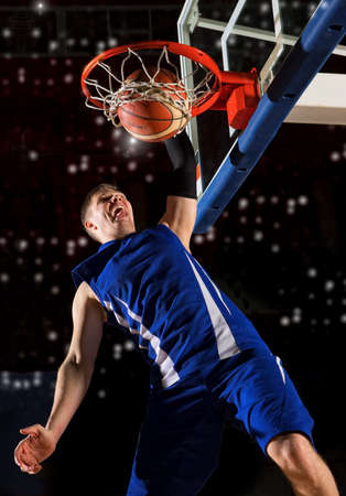 Basketball player in action in gym Stock Photo