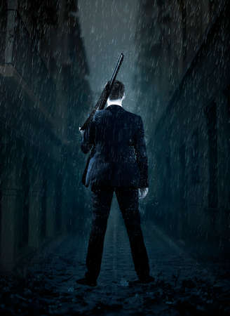 Businessman gangster shooting with gun. Design for cover 写真素材