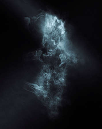 Terrible ghost on dark smoke background