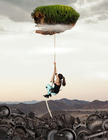 Woman climbing the rope up. Ecologic, pollution concept. Mix media