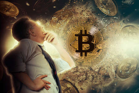 Businessman look on bitcoin coin. Cryptocurrency concept