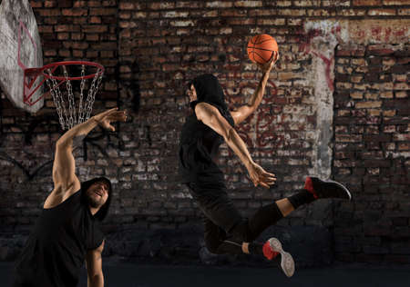Two street basketball players in action.  Streetball concept Stockfoto