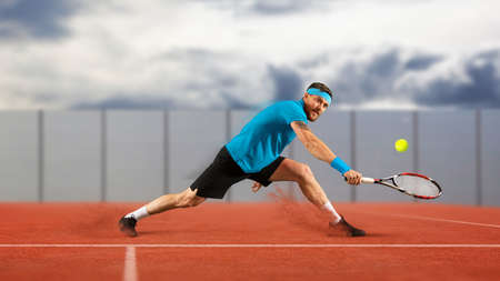 Man tennis player in action during game Stockfoto
