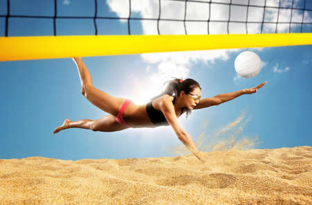 Female volley ball beach player in action
