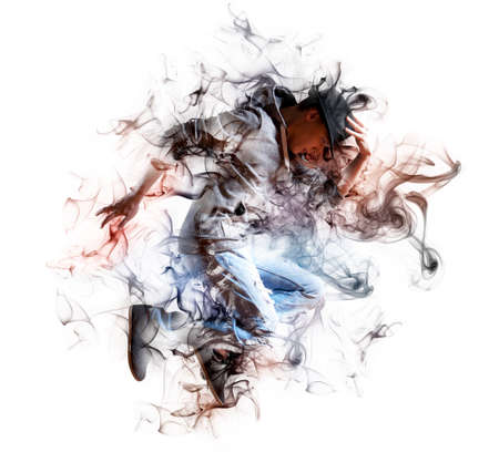 Young man break dancing on dark smoke background 版權商用圖片