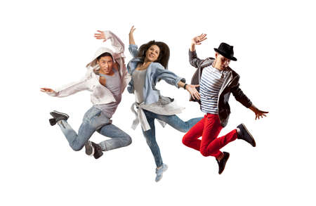 Beautiful young trio in dance studio. Sporty hip-hop dancers Stock Photo