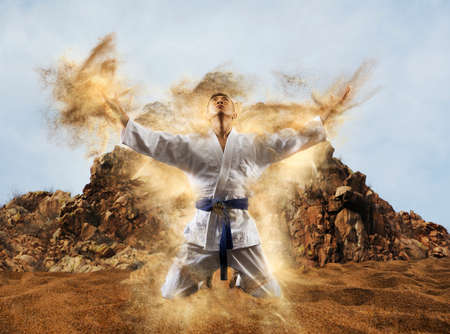 Man in kimono practicing. Fighter concept
