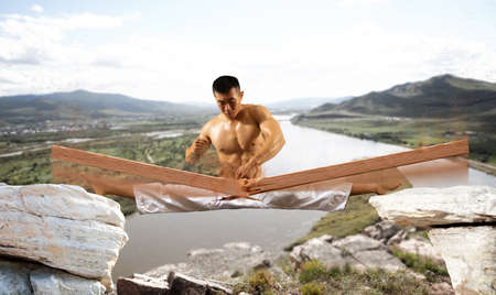 Man in kimono practicing. Fighter concept. Breaking board