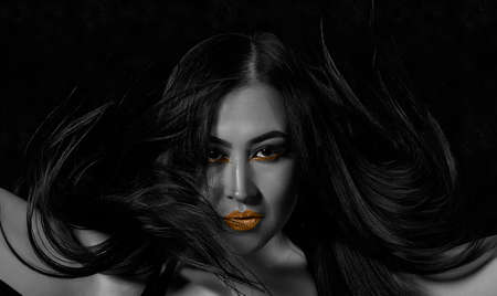 High fashion model woman. Art gold skin girl face portrait closeup. Glamour professional makeup