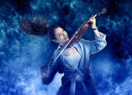 Woman playing violin on on smoke background