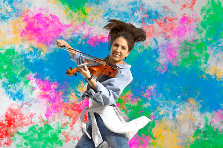 Woman playing violin on on splash background