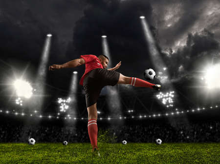 Soccer player in action on dark arena background