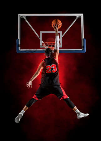 Basketball player players in action. Basketball concept on dark background