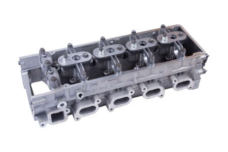 The cylinder head of the internal combustion engine. Isolated on white background.
