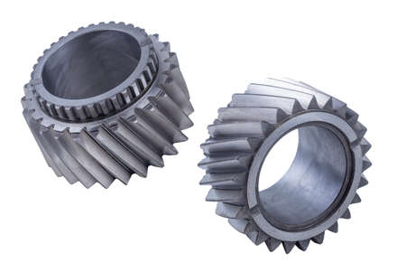 steel gears and shafts of truck engine and gearbox isolated on white background