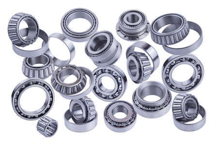 Bearings of different types in a row isolated on white background.