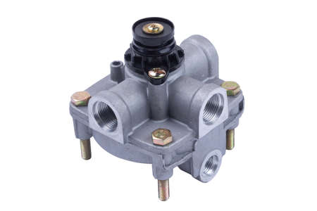 The valve of the accelerator brake system of a truck on an isolated white background. Distributes compressed air flows between the elements of the pneumatic system. Banque d'images