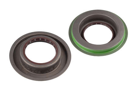 Two rubber reinforced oil seals for shafts and for car motor engines, isolated on white background. Cuffs for prevent liquid leak. Car parts.